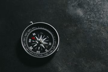 compass on a dark background concept for direction, travel, guidance or assistance- Stock Photo or Stock Video of rcfotostock | RC-Photo-Stock