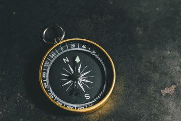 compass on a table concept for direction, travel, guidance or assistance- Stock Photo or Stock Video of rcfotostock | RC-Photo-Stock