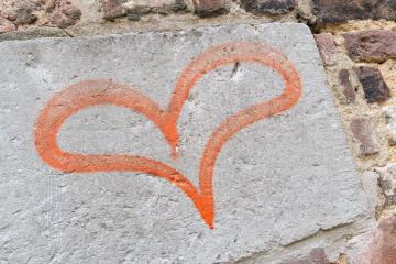 Concept or conceptual painted red abstract heart shape love symbol, dirty wall background, metaphor to urban and romantic valentin : Stock Photo or Stock Video Download rcfotostock photos, images and assets rcfotostock | RC-Photo-Stock.:
