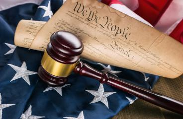 Constitution of america with judge gavel on a USA flag- Stock Photo or Stock Video of rcfotostock | RC-Photo-Stock