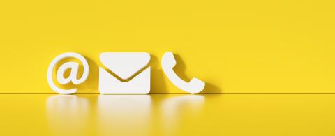 Contact Methods. Close-up Of A Phone, Email and Post Icons Leaning On orange Wall- Stock Photo or Stock Video of rcfotostock | RC-Photo-Stock