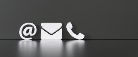 Contact Methods. Close-up Of A Phone, Email and Post Icons Leaning On black Wall- Stock Photo or Stock Video of rcfotostock | RC-Photo-Stock