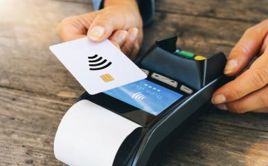 Contactless payment concept, female customer holding credit card near nfc technology on counter, client make transaction pay bill on terminal rfid cashier machine in restaurant or store, close up view- Stock Photo or Stock Video of rcfotostock | RC-Photo-Stock