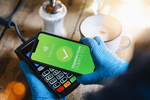 contactless payment on a mobile phone. Close up of a woman hand paying contactless with a smartphone screen application. Hand holding smart device to pay. Mockup cellphone screen.- Stock Photo or Stock Video of rcfotostock | RC-Photo-Stock
