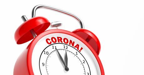 Corona Coronavirus COVID-19 text as concept on a red vintage alarm clock- Stock Photo or Stock Video of rcfotostock | RC-Photo-Stock