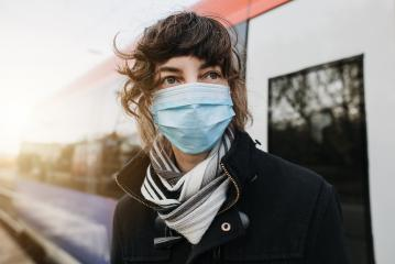 Corona virus, COVID-19. Young german woman with medical face mask to protect against the coronavirus on a train station at the subway platform. Mouth protection. Pandemic Germany : Stock Photo or Stock Video Download rcfotostock photos, images and assets rcfotostock | RC-Photo-Stock.: