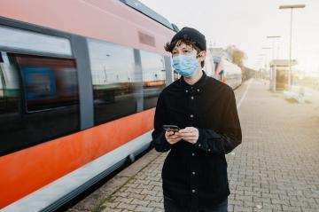 Coronavirus, COVID-19. Young german man with medical face mask to protect against the coronavirus while waiting for the train on the subway platform. Mouth protection obligation at the train station : Stock Photo or Stock Video Download rcfotostock photos, images and assets rcfotostock | RC-Photo-Stock.:
