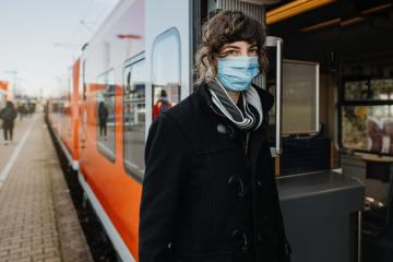 Coronavirus, COVID-19. Young german woman with medical face mask to protect against the coronavirus while waiting for the train on the subway platform. Mouth protection obligation at the train station- Stock Photo or Stock Video of rcfotostock | RC-Photo-Stock