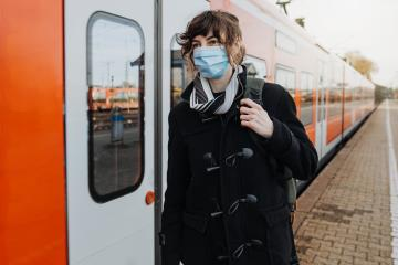 Coronavirus, COVID-19. Young german woman with medical face mask to protect against the coronavirus while waiting for the train on the subway platform. Mouth protection obligation at the train station : Stock Photo or Stock Video Download rcfotostock photos, images and assets rcfotostock | RC-Photo-Stock.: