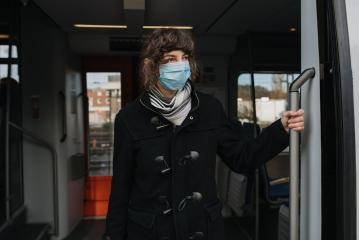 Coronavirus, COVID-19. Young modern woman with medical face mask to protect against the coronavirus while getting in the train on the subway platform. Mouth protection at the train station. : Stock Photo or Stock Video Download rcfotostock photos, images and assets rcfotostock | RC-Photo-Stock.: