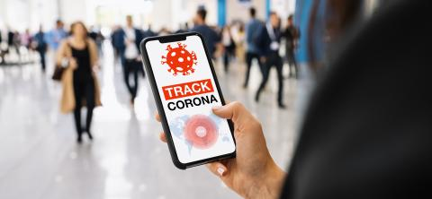 coronavirus tracker app on a mobile smartphone. Close up of woman tracking crowd of people in a smartphone screen application. Hand holding smart device. Mockup website. covid-19 corona virus tracker- Stock Photo or Stock Video of rcfotostock | RC-Photo-Stock