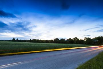 Country road with car light strips at dusk : Stock Photo or Stock Video Download rcfotostock photos, images and assets rcfotostock | RC-Photo-Stock.: