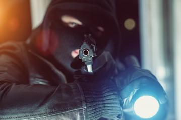 criminal Burglar looking and holding a gun with flashlight to entering a house at night- Stock Photo or Stock Video of rcfotostock | RC-Photo-Stock