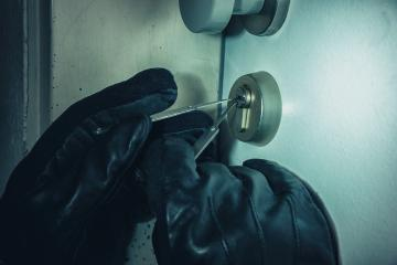 Criminal Picking Lock with Black Leather Gloves at Night : Stock Photo or Stock Video Download rcfotostock photos, images and assets rcfotostock | RC-Photo-Stock.: