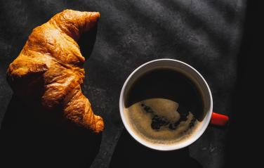 Croissants with coffee. french croissants on plate and red cup of coffee on a dark table background, top view- Stock Photo or Stock Video of rcfotostock | RC-Photo-Stock
