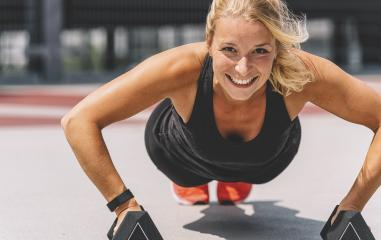 Cross training. Young woman exercising with dumbbells- Stock Photo or Stock Video of rcfotostock | RC-Photo-Stock