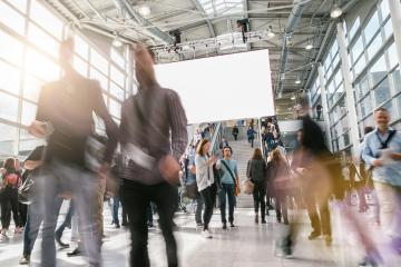 crowd of anonymous blurred business people at a trade fair hall- Stock Photo or Stock Video of rcfotostock   RC-Photo-Stock