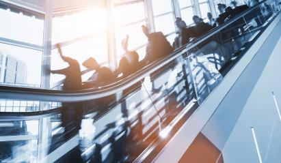 crowd of anonymous blurred business people rushing on a escalator in a business center- Stock Photo or Stock Video of rcfotostock | RC-Photo-Stock