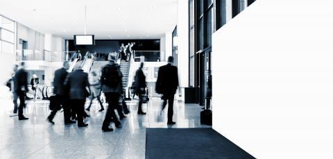 crowd of anonymous blurred people at a trade show, with banner and copy space for individual text - Stock Photo or Stock Video of rcfotostock | RC-Photo-Stock
