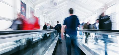 crowd of anonymous blurred people on a escalator at a trade show- Stock Photo or Stock Video of rcfotostock | RC-Photo-Stock