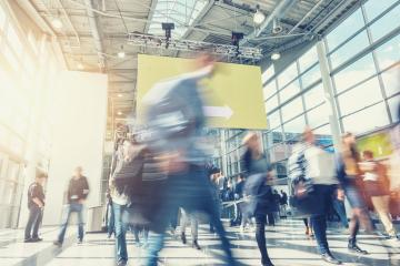 crowd of anonymous blurred people rushing at a trade show- Stock Photo or Stock Video of rcfotostock | RC-Photo-Stock