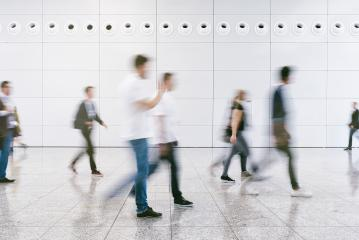 crowd of anonymous blurred people walking in a modern hall- Stock Photo or Stock Video of rcfotostock | RC-Photo-Stock
