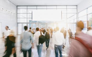 Crowd of anonymous people walking at a trade show, with copy space banner- Stock Photo or Stock Video of rcfotostock | RC-Photo-Stock