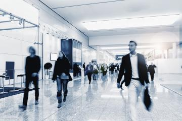 Crowd of anonymous people walking on a trade show- Stock Photo or Stock Video of rcfotostock | RC-Photo-Stock
