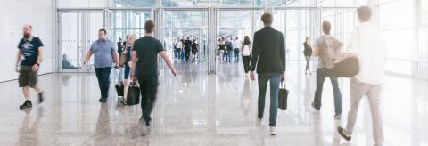 Crowd of anonymous people walking on trade fair entrance- Stock Photo or Stock Video of rcfotostock | RC-Photo-Stock