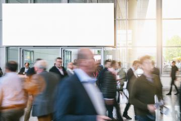crowd of blurred business people at a trade show, with copy space banner- Stock Photo or Stock Video of rcfotostock | RC-Photo-Stock