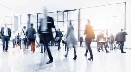 crowd of blurred business people rushing in a trade show hall- Stock Photo or Stock Video of rcfotostock | RC-Photo-Stock