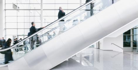 crowd of blurred business people rushing on escalators- Stock Photo or Stock Video of rcfotostock | RC-Photo-Stock
