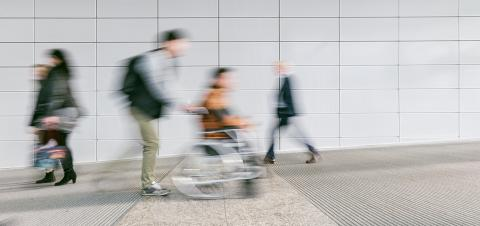 crowd of blurred people with wheelchair driver- Stock Photo or Stock Video of rcfotostock | RC-Photo-Stock