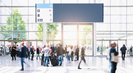 Crowd of business people walking at a airport, with banner and copy space for individual text- Stock Photo or Stock Video of rcfotostock | RC-Photo-Stock