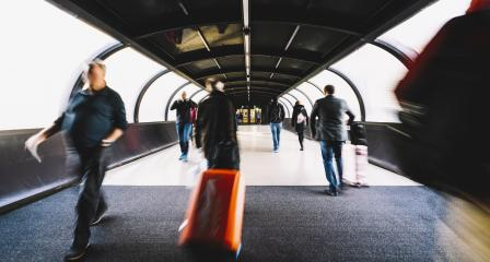 crowd of commuters rushing through in a airport terminal tunnel- Stock Photo or Stock Video of rcfotostock | RC-Photo-Stock
