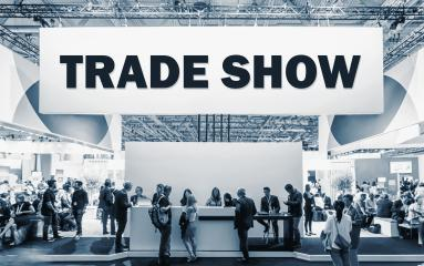 Crowd of people at a trade show booth with a banner and the text Trade Show. : Stock Photo or Stock Video Download rcfotostock photos, images and assets rcfotostock | RC-Photo-Stock.: