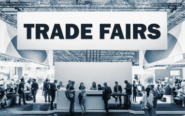 Crowd of people at a trade show booth with a banner and the text Trade Fairs. : Stock Photo or Stock Video Download rcfotostock photos, images and assets rcfotostock | RC-Photo-Stock.: