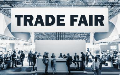 Crowd of people at a trade show booth with a banner and the text Trade Fair. : Stock Photo or Stock Video Download rcfotostock photos, images and assets rcfotostock | RC-Photo-Stock.: