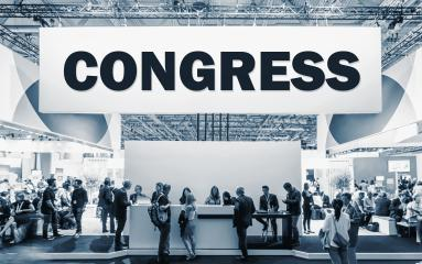 Crowd of people at a trade show booth with a banner and the text Congress.- Stock Photo or Stock Video of rcfotostock | RC-Photo-Stock