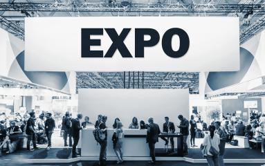 Crowd of people at a trade show booth with a banner and the text EXPO.- Stock Photo or Stock Video of rcfotostock | RC-Photo-Stock
