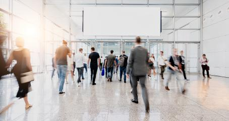 Crowd under blank billboard on trade fair, with copyspace for your individual text.- Stock Photo or Stock Video of rcfotostock | RC-Photo-Stock