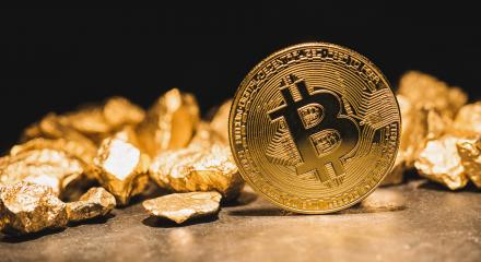 cryptocurrency Bitcoin and mound of gold nuggets - Business concept image- Stock Photo or Stock Video of rcfotostock | RC-Photo-Stock