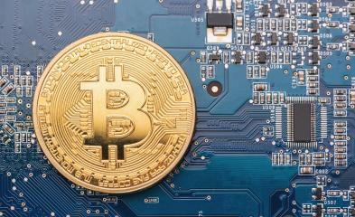 cryptocurrency Bitcoin on a Mother board- Stock Photo or Stock Video of rcfotostock | RC-Photo-Stock
