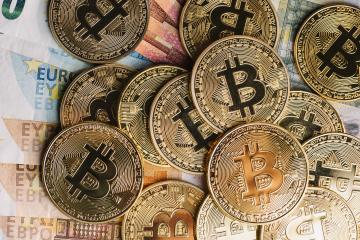 cryptocurrency Bitcoin, on top of Euro banknotes- Stock Photo or Stock Video of rcfotostock | RC-Photo-Stock