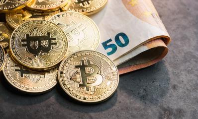 cryptocurrency Bitcoins, on top of Euro banknotes : Stock Photo or Stock Video Download rcfotostock photos, images and assets rcfotostock | RC-Photo-Stock.:
