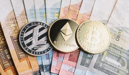 cryptocurrency coins - Litecoin, Bitcoin, Ethereum on top of Euro banknotes- Stock Photo or Stock Video of rcfotostock | RC-Photo-Stock