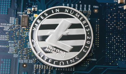 Cryptocurrency physical silver litecoin coin on motherboard- Stock Photo or Stock Video of rcfotostock | RC-Photo-Stock