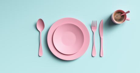Cup of coffee with pink fork, knife and spoon, top view. Clear ceramic dishware with set cutlery design. Empty green table ware for lunch or dinner in cafe. copyspace for your individual text.- Stock Photo or Stock Video of rcfotostock | RC-Photo-Stock
