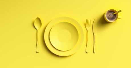 Cup of coffee with yellow fork, knife and spoon, top view. Clear ceramic dishware with set cutlery design. Empty green table ware for lunch or dinner in cafe. copyspace for your individual text.- Stock Photo or Stock Video of rcfotostock | RC-Photo-Stock