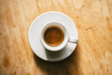 cup of espresso coffee on wooden table background, top view shot- Stock Photo or Stock Video of rcfotostock | RC-Photo-Stock